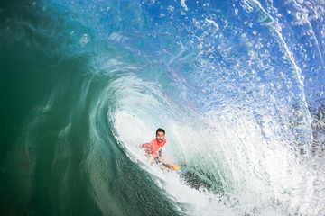 Surfing Bodyboarder Inside Hollow Wave