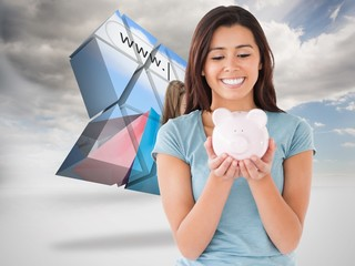 Composite image of attractive woman posing with a piggy bank
