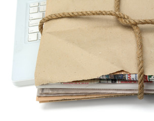 A newspaper stack isolated on wood background.