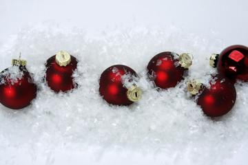 Christmas balls on snow.