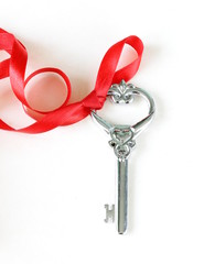 Vintage key with a festive beautiful red ribbon