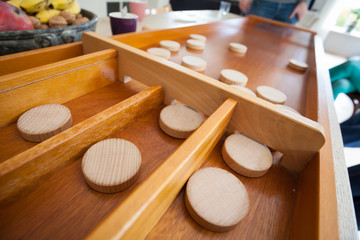 A traditional Dutch game called 'sjoelen'. The wooden disks hove