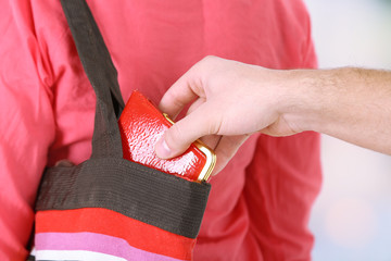 Pickpocket are stealing wallet from bag, close up,
