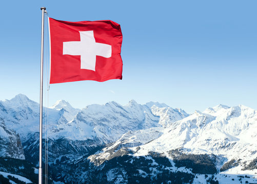 Swiss Flag Flying Over Alpine Scenery