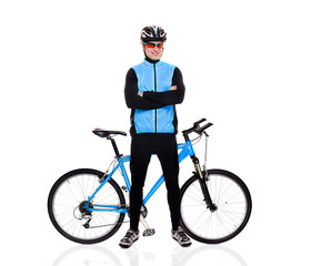 cyclist standing next to his blue bicycle