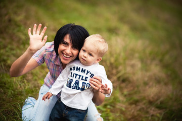 mother and son waving his hand all