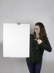 Pretty young woman holding blank sign