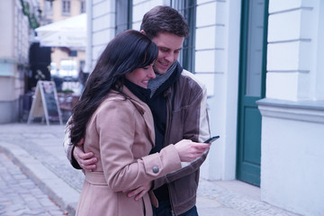 Couple looking at picture on cellphone