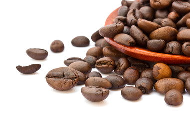 Fresh coffee beans with wooden spoon isolated over white