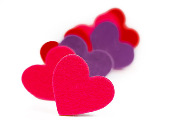 Many colored heart shapes in a row