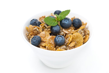 delicious muesli with fresh blueberries and mint, isolated
