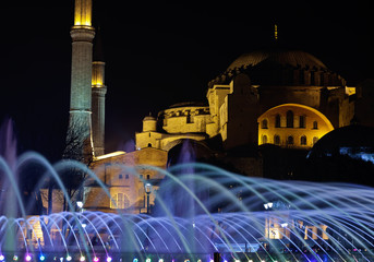 Night scene in Sultanahmet with glowing fountain and Agia Sophia