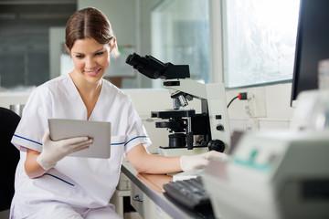 Scientist Using Digital Tablet In Lab