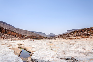 People on the stone river, Draa valley (Morocco)