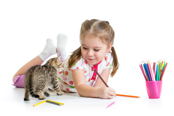 child drawing with pencils and playing with kitten