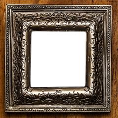 Vintage photo frame over wooden background