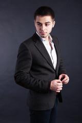 Handsome young man on dark background