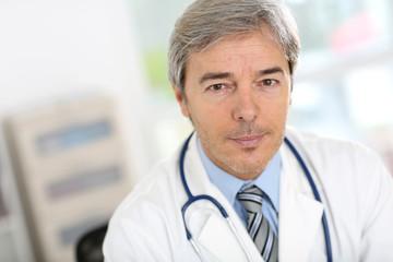 Portrait of attractive senior doctor