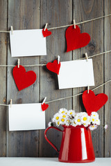 Photos and hearts on wooden wall