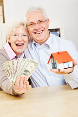 Family with dollar and small house