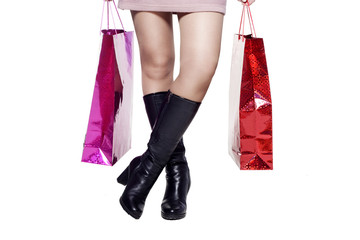 Woman legs after shopping