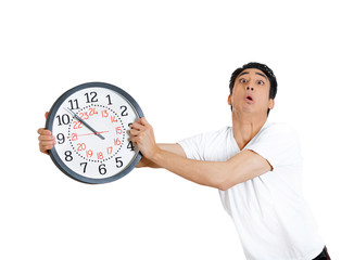 Hurried man holding clock