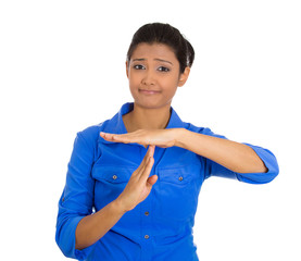 Woman showing time out gesture