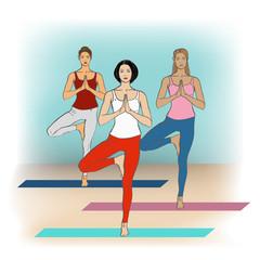 Yoga Studio. Yoga class. Women in yoga poses in yoga class.