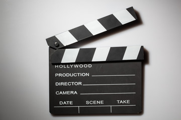 Clapperboard cinema on white