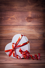 gift box heart on wooden background