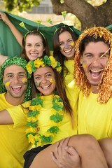 Group of sport soccer fans celebrating victory.
