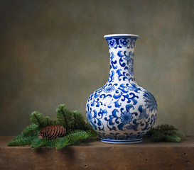 Still life with chinese vase and fir branches