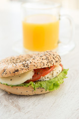 Mozarella cheese and tomato sandwich with juice