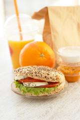 Sesame and poppyseed sandwich with fresh orange juice