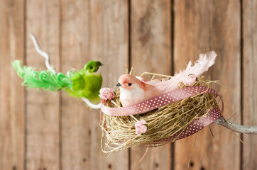 Easter or spring wood background - bird nest on twig