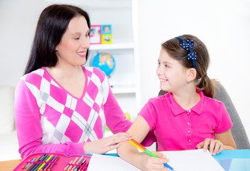 Mother helps daughter of homework and have fun
