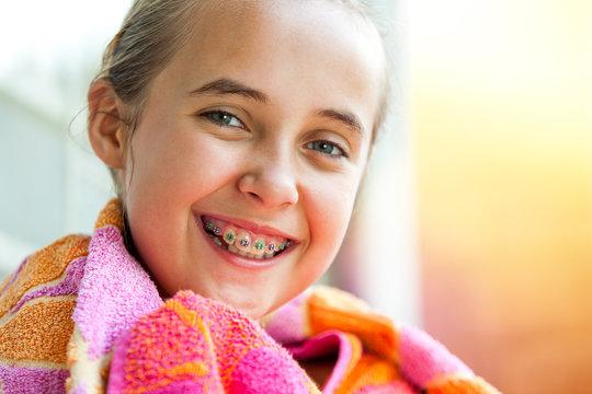 Cute girl with dental braces.
