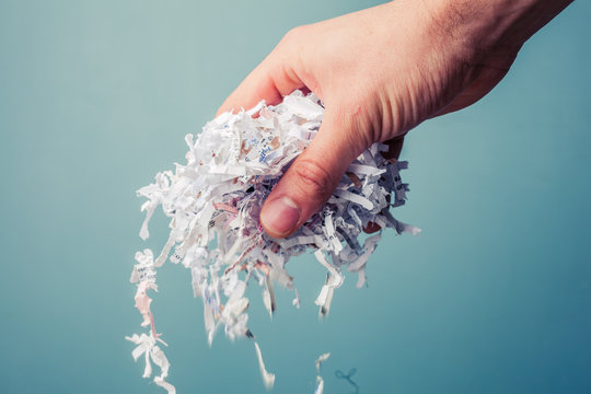 Hand with shredded paper