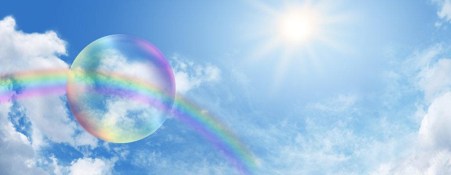 Rainbow bubble on blue sky