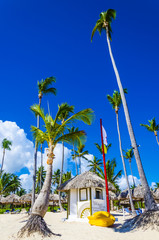 Holiday cottage and yellow kayak on Dominicana beach - fototapety na wymiar