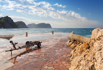 Stone breakwater and old boat trailer, Montenegro