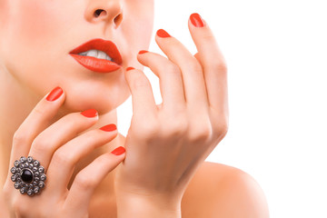 face and beautiful red manicure. isolated
