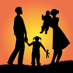 silhouette di famiglia al tramonto
