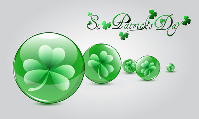 St. Patrick's Day card with three leaf clovers in glass balls