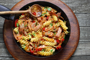 Fried pasta with pork ham and paprika