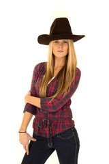 Stunning female model in cowboy hat with a stoic look