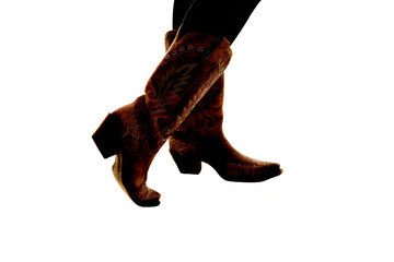 Wall Mural - semi silhouette of cowboy boots on a white background