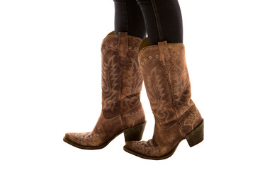 Close up of a pair of cowboy boots white background