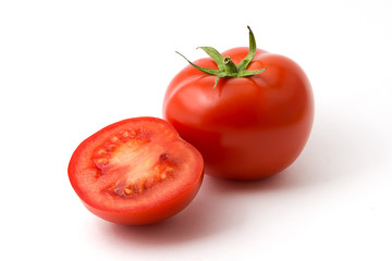 Tomato and half a tomato on a white background