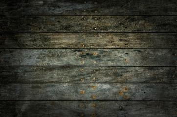 A dark grungy wooden background